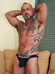 Ultra-piggy bottom Bo Bangor shows off his hairy pits and tattooed ass in this smoking solo photo set