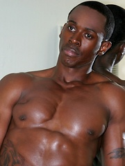 Beefy black thug shows his perfect muscled chest