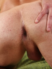 Smooth chested Angel Weis strokes his thick cock.
