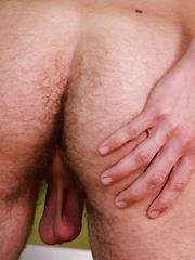 Frat boy Myles Cumbersome blasts cum onto his tummy.